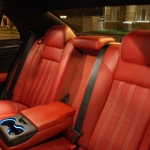 Red nappa leather fits well to black dominated colour treatment