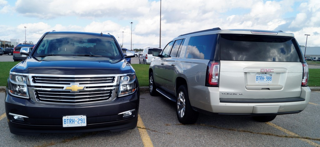 General Motors offers its super-sized SUV's under three different brands: Chevrolet Suburban, GMC Yukon XL and Cadillac Escalade (not in the picture)