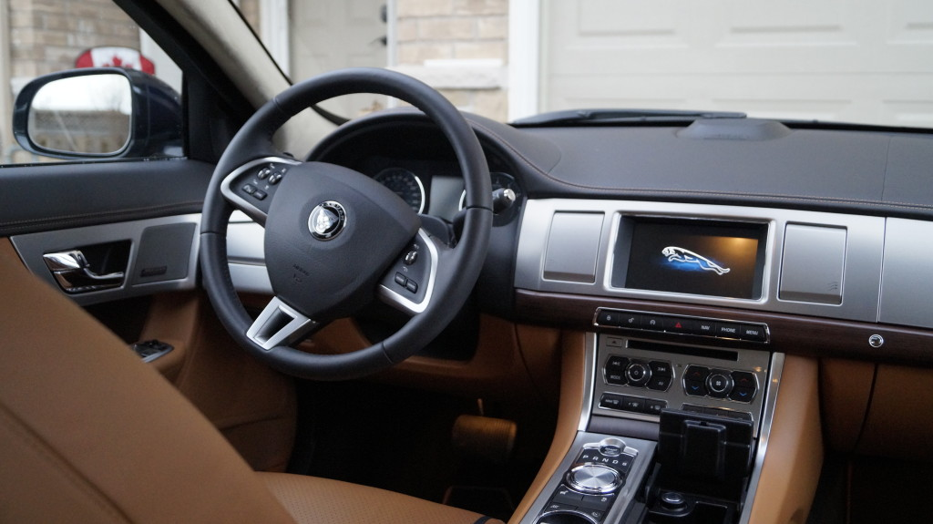 The Soft grain leather stitched and tailored instrument panel, and Knurled Aluminum with Satin Rosewood veneer complete the British elegance and luxury.