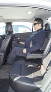 The legroom in the rear is fine. However, the rear seats are uncomfortable and not up to the standards of the middle class.