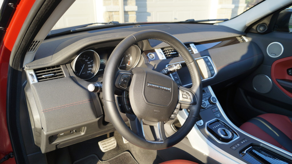 The leather dashboard has an ergonomic design smoothly tilting towards the driver.